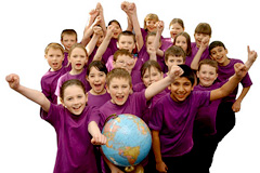 Excited children holding world globe