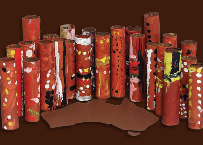 Cardboard rolls painted as totem poles