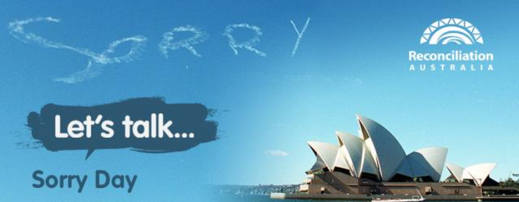 the word sorry in the sky against sydney opera house